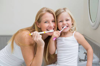 Mother and daughter brushing