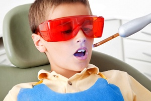 A young boy in the dentist chair