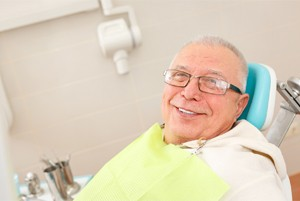 An older man in the dental chair