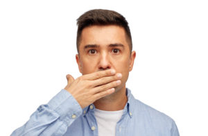 Man hiding his teeth.