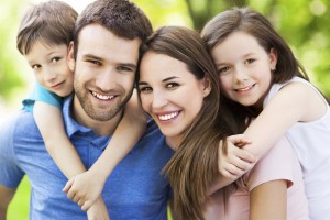 Happy family with beautiful smiles thanks to your whiting dentist Berquist Family Dentistry